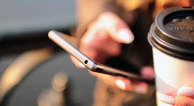 smartphone, coffee mug, sepia tone